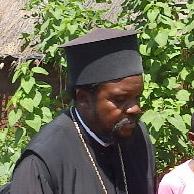 π. Χαρίτων Musungayi