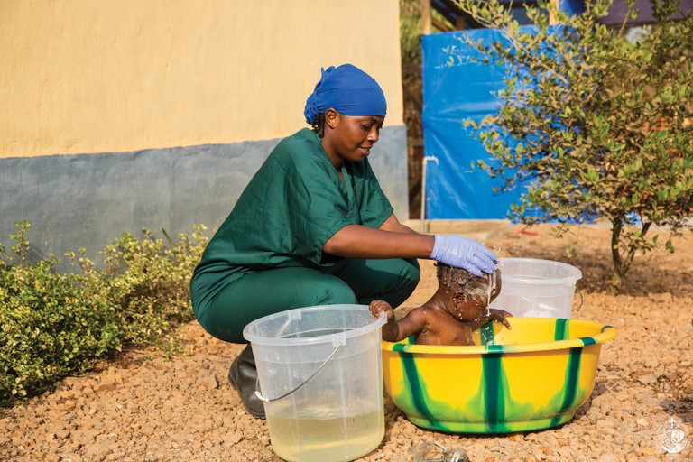Infant cleaning by the Prevention Service against Ebola CC-BY United Nations Photo